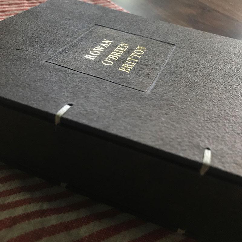 hand-bound walnut dyed baby book