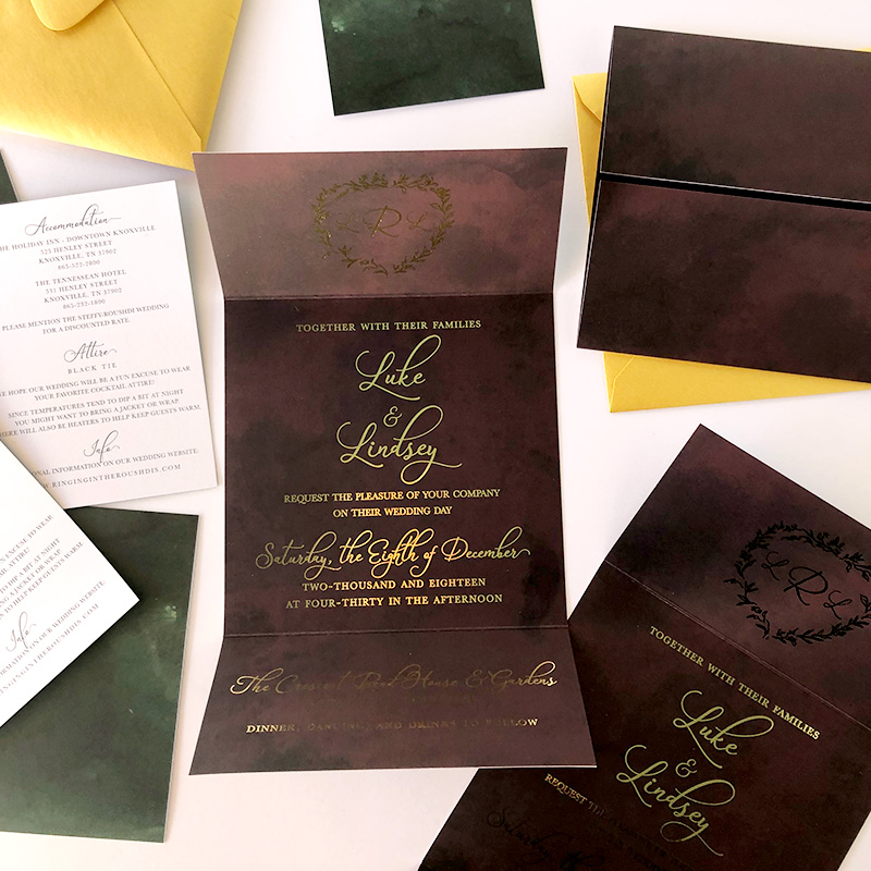 Winter wedding stationery. Dramatic berry and pine palette and gold foil accents.