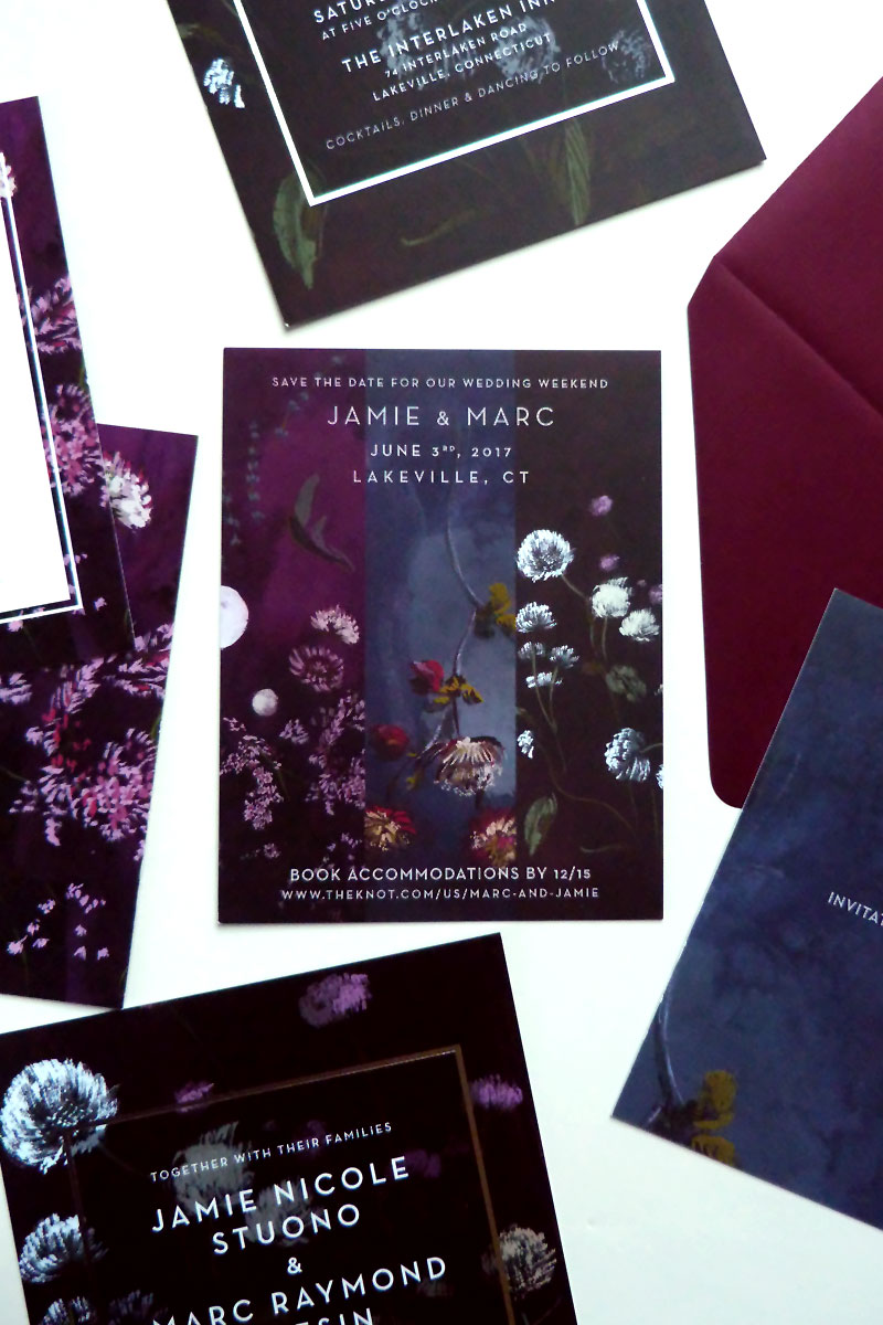 jolly edition dark, bold, contrasting hand painted save the date. Deep blue, aubergine, maroon, wines