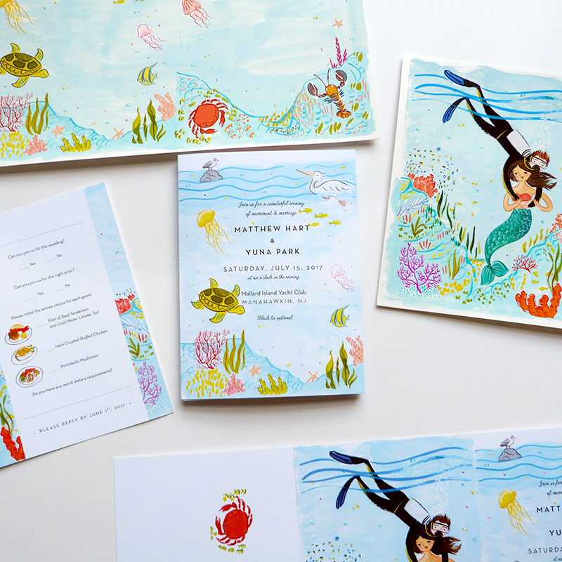 Jolly Edition Blog Post May 2017 Under the Sea theme wedding invitation suite. Fold out invitation with tear away RSVP postcard. Mermaid, coral, fish, crab, pelican, fish, seagull, lobster illustration.