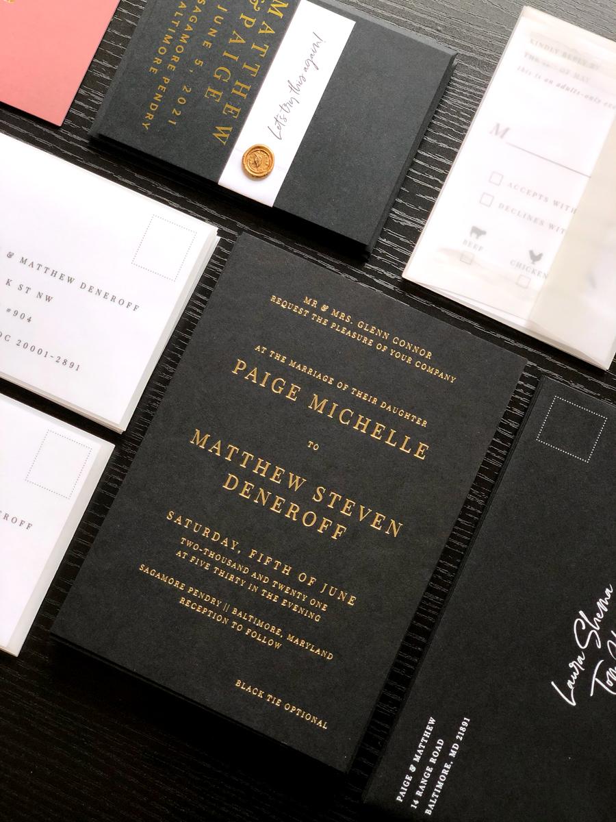 black, white, and gold-foil wedding invitations